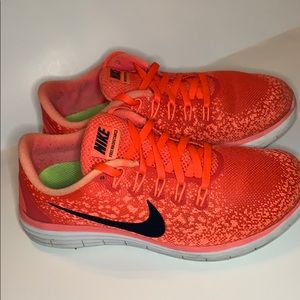 Nike size 6 women's or 4 Girl  orange athletic